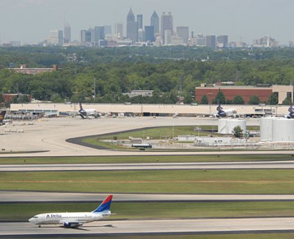 Delta plane with Downtown Atlanta in the background (c byusatoday.com)