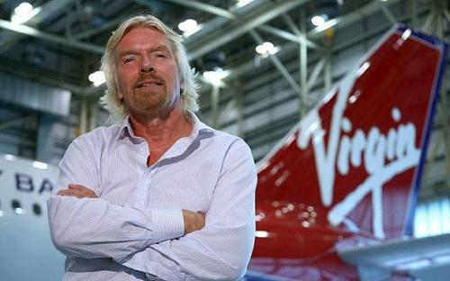 Richard Branson with a Virgin plane's tailfin